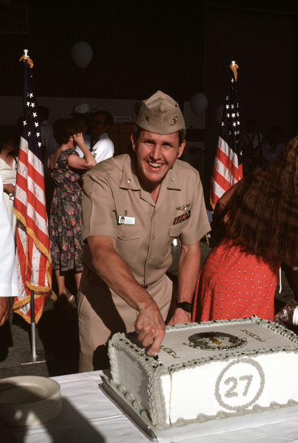 Commander Joe Hart cuts a cake to celebrate the return of the Light Attack Squadron 27 (VA-27) to their home base