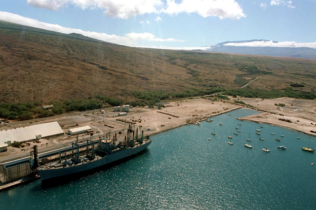 An aerial view of Kawaihae Harbor, where hundreds of vehicles of the 2nd Brigade, 25th Infantry Division, and other units wait to be loaded aboard the vehicle cargo ship USNS METEOR (T-AKR 9). The equipment is being shipped back to Oahu and Schofield Barraks after a month-long training deployment at the US Army`s Pohakuloa Training Area. (Substandard image)
