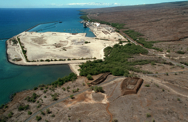 An aerial view of Kawaihae Harbor, where hundreds of vehicles of the 2nd Brigade, 25th Infantry Division, and other units wait to be loaded aboard the vehicle cargo ship USNS METEOR (T AKR 9). The equipment is being shipped back to Oahu and Schofield Barracks after a month-long training deployment at the US Army`s Pohakuloa Training Area