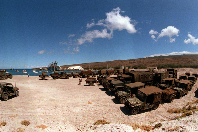 Vehicles of the 2nd Brigade, 25th Infantry Division, and other units wait to be loaded aboard the vehicle cargo ship USNS METEOR (T AKR 9). The equipment is being shipped back to Oahu and Schofield Barracks after a month-long training deployment at the US Army`s Pohakuloa Training Area