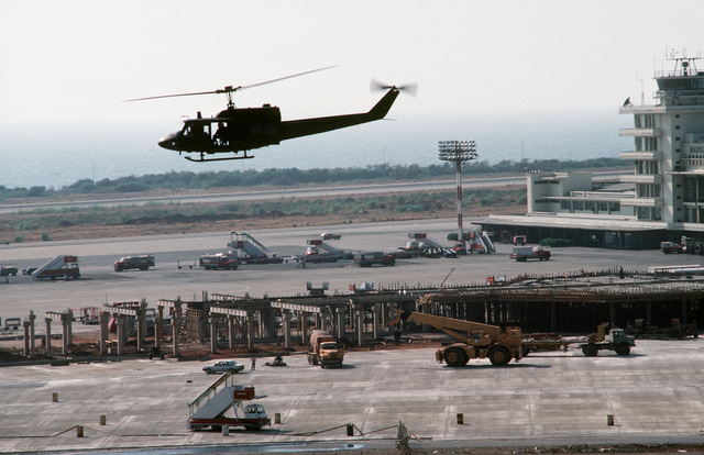 A Marine Corps UH-1N Iroquois helicopter flies over the Beirut International Airport during a patrol for the multinational peacekeeping force