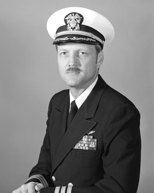 Commander Christopher G. Overton, USN (covered)