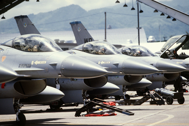 Preflight maintenance is performed on F-16 Fighting Falcon aircraft parked on the flight line during Exercise COPE THUNDER 83-7