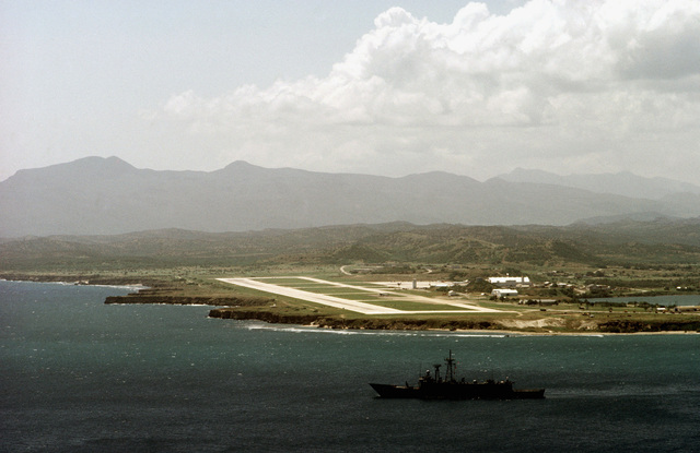 The guided missile frigate USS STARK (FFG 31) passes Naval Base Guantanamo Bay as it heads out to sea for a day of training