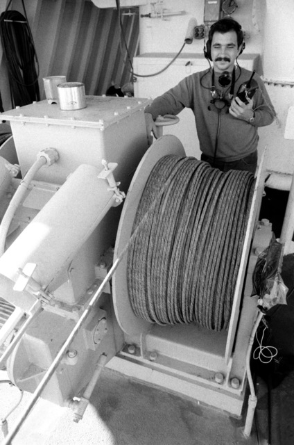 A civilian contractor stands behind cable attached to a sonar device during salvage operations for downed Korean Air Lines Flight 007 (KAL 007).  The commercial jet was shot down by Soviet aircraft over Sakhalin Island in the Sea of Japan on August 30, 1983.  All 269 passengers and crewmen were killed