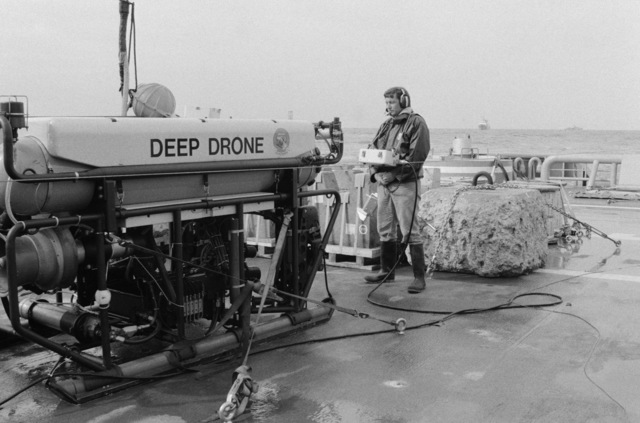 A civilian contractor tests the unmanned submersible Deep Drone aboard a US Navy ship.  The sonar device is being used during salvage operations for downed Korean Air Lines Flight 007 (KAL 007).  The commercial jet was shot down by Soviet aircraft over Sakhalin Island in the Sea of Japan on August 30, 1983.  All 269 passengers and crewmen were killed