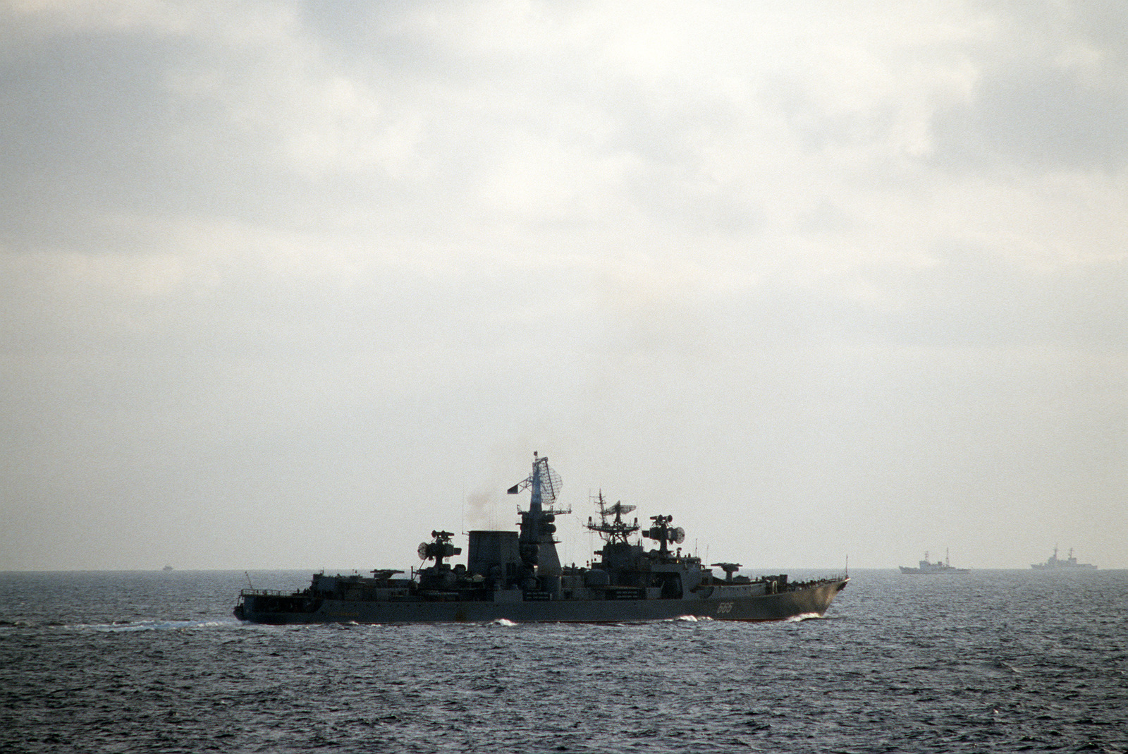 A starboard view of the Soviet guided missile cruiser PETROPAVLOVSK (565) shadowing salvage operations for downed Korean Air Lines Flight 007 (KAL-007).  The commercial jet was shot down by Soviet aircraft over Sakhalin Island on August 30, 1983 in the Sea of Japan.  All 269 passengers and crewmen were killed