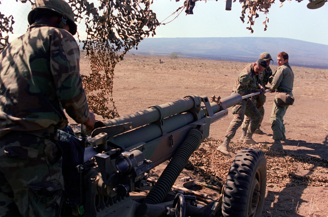 Members of the 4th Section of Btry. C, 2nd Bn., 11th Field Arty., 25th Inf. Div., clean their M-102 105mm howitzer during live-fire artillery exercises at the U.S. Army's Pohakuloa Training Area. Their unit is preparing for Team Spirit '84, a joint South Korean/U.S. training exercise held annually in Korea