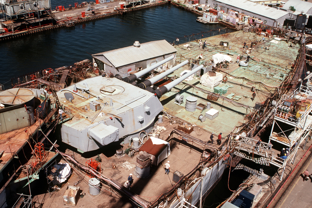 The 16-inch gun turret on the aft section of the battleship USS IOWA (BB 61) during its reactivation at Ingalls Shipbuilding Corp. The circular structure to the left is the base for SKY-4, the aft 5-inch gun director which serves as a backup for the 16-inch main battery gun director