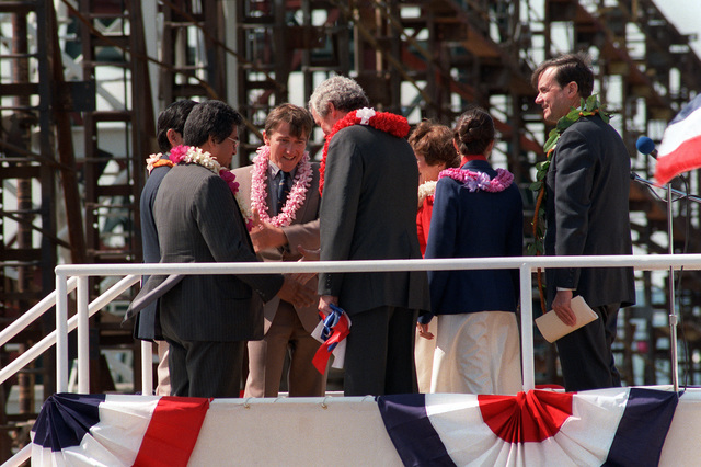 A view of distinguished guests after the launching of the nuclear-powered attack submarine HONOLULU (SSN-718) at Newport News Shipbuilding. Secretary of the Navy John F. Lehman Jr. (center) and William P. Clark, assistant to the president for National Security Affairs (right), are among the guests