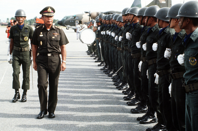 General Saiyud Kerdphol, Supreme Commander of the Royal Thai Armed Forces, reviews the troops at the opening ceremony for Operation MITRAPAB (Thai word for friendship), an annual parachute demonstration conducted by the Thai military and the Joint United States Military Advisory Group (JUSMAG). Proceeds from the event are used to build schools in Thailand