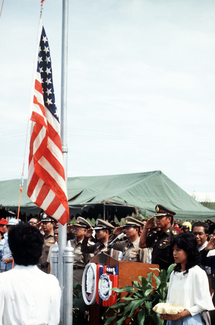 General Saiyud Kerdphol, Supreme Commander of the Royal Thai Armed Forces, salutes as the American flag is raised during Operation MITRAPAB (Thai word for friendship), an annual parachute demonstration conducted by the Thai military and the Joint United States Military Advisory Group (JUSMAG). Proceeds from the event are used to build schools in Thailand