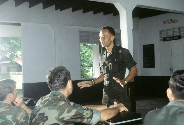 Major Chaichorn of the Royal Thai Army Special Forces, a former prisoner of war, lectures U.S. Air Force personnel on POW survival techniques during jungle survival cross-training