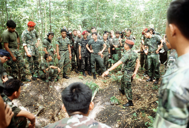 Royal Thai Army Special Forces and U.S. Air Force personnel are instructed in how to trap and cook small animals using only items available in the jungle during jungle survival cross-training