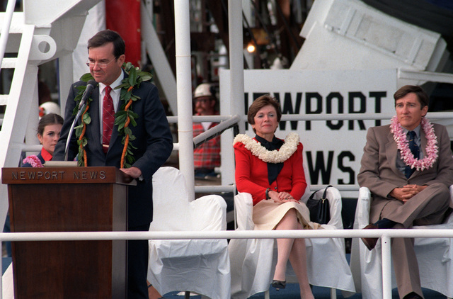 William P. Clark, assistant to the president for National Security Affairs, speaks at the launching ceremony for the nuclear-powered attack submarine HONOLULU (SSN-718). Secretary of the Navy John F. Lehman Jr. (right) looks on