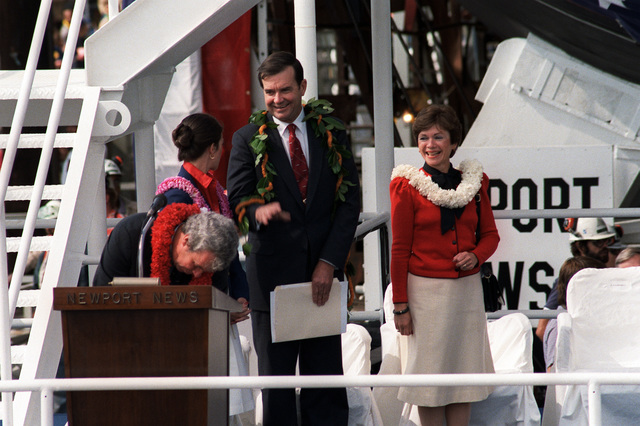 William P. Clark, assistant to the president for National Security Affairs, stands with his wife Joan (right), and daughter Nina, during the launching ceremony for the nuclear-powered attack submarine HONOLULU (SSN-718)