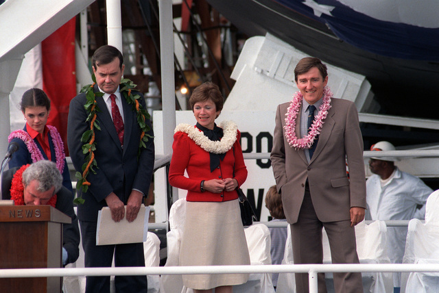 William P. Clark (left), assistant to the president for National Security Affairs, stands with his wife Joan (center), and Secretary of the Navy John F. Lehman Jr., during the launching ceremony for the nuclear-powered attack submarine HONOLULU (SSN-718)