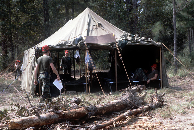 Members of the 2nd Mobile Aerial Port Squadron relax in their tent at the Remagen Drop Zone, approximately 40 miles from Travis Field, during the 314th Tactical Airlift Wing's operational readiness exercise Purple Penny