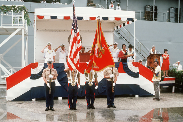A US Marine Corps color guard participates in the welcoming ceremony for the combat stores ship USS NIAGARA FALLS (AFS 3) (AFS 3) (background)