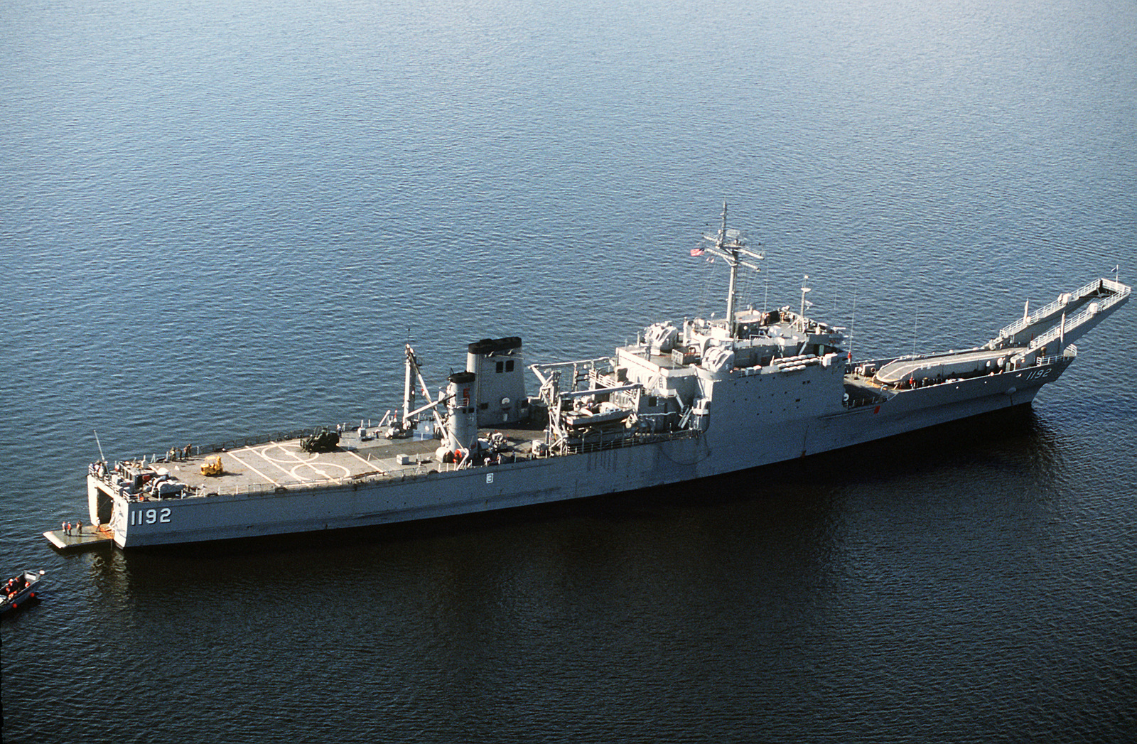 An aerial starboard quarter view of the tank landing ship USS SPARTANBURG County (LST-1192) in use during Exercise Patriot Samaritan