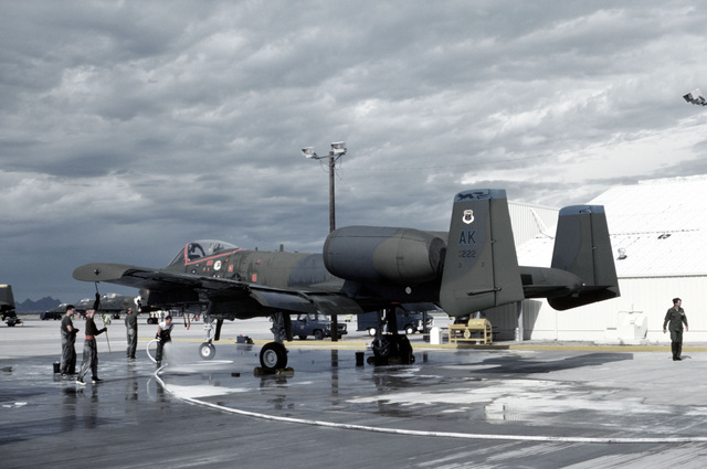 Ground crewman wash an A-10A Thunderbolt II aircraft of the 18th Tactical Fighter Squadron, 343 Composite Wing prior to a flight to Nellis Air Force Base, Nevada, to participate in a Gunsmoke gunnery meet