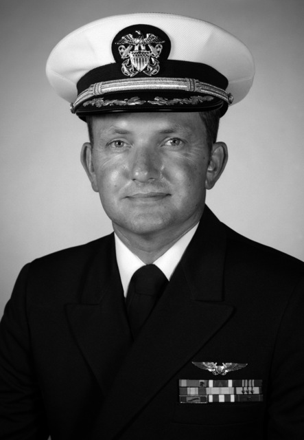 Commander Eugene M. Krier, USN (covered)