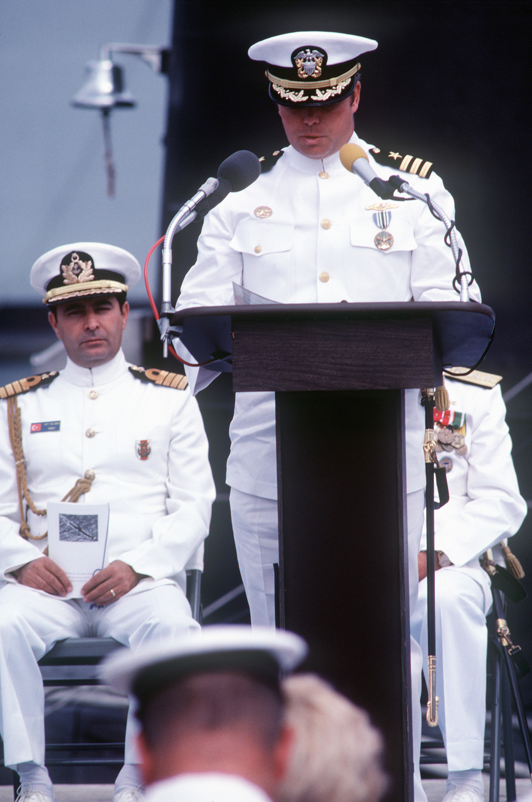 Commander G. Mike Wilson, ex-commanding officer, reads the decommissioning and transferring orders for the ex-USS GUDGEON (SSAG 567). The Tang class submarine, upon decommissioning, is being immediately transferred to the Turkish Navy on a five-year lease. The submarine is being renamed to TCG HIZIR REIS (S 342)