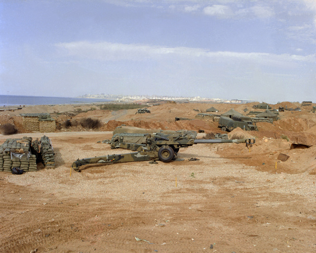 A right side view of 155mm M-1908 howitzer erected at a Marine position near the Beirut Internatioal Airport. The Marines have been deployed in Lebanon as part of a multinational peackeeping force following confrontation between Israeli forces and the Palestine Liberation Organization