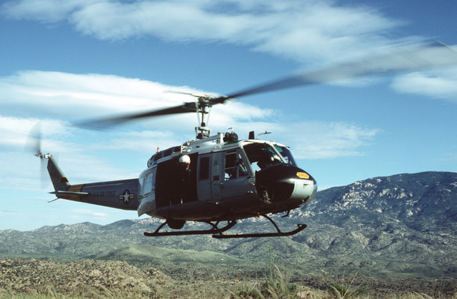 A right side view of a UH-1 Iroquois helicopter participating in rescue efforts along the Palo-Verde River. Record rainfalls on the first two days of October caused extreme flood devastation along the river in and around Tucson. The helicopter is assigned to Detachment 1, 37th Aerospace Rescue and Recovery Squadron, Davis-Monthan Air Force Base