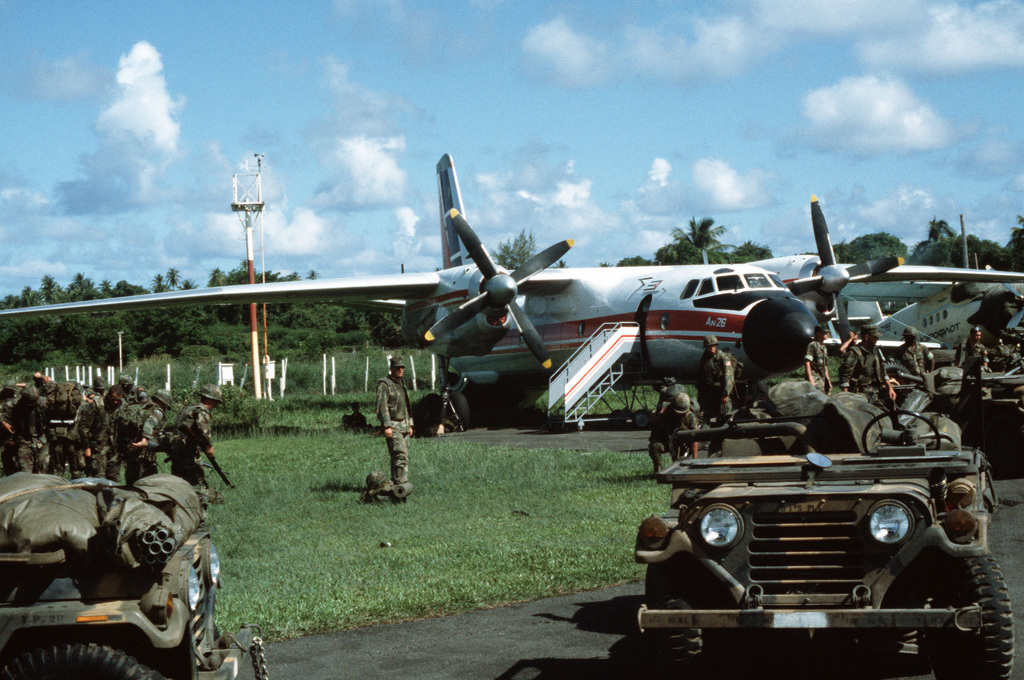 US Marines congregate around a Soviet-made An-26 Curl transport aircraft of Cubana airlines seized at Pearls Airport during Operation URGENT FURY
