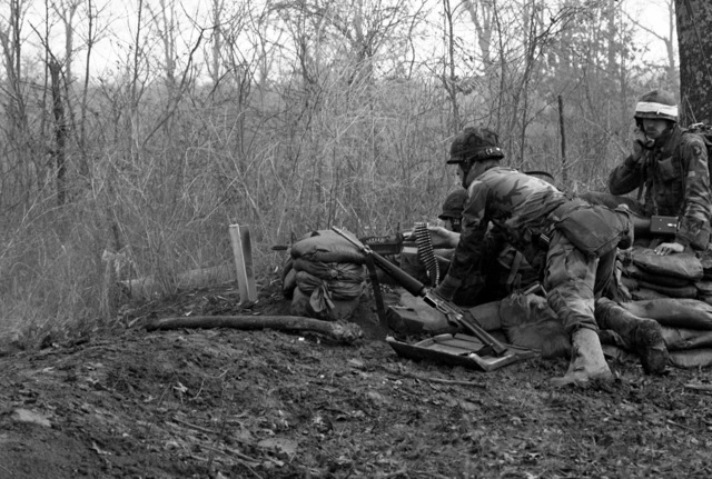 Members of an M-60 machine gun crew from Co. A, 1/506th Infantry, fire their weapon during an Army Training and Evaluation Program (ARTEP) exercise at Range 42