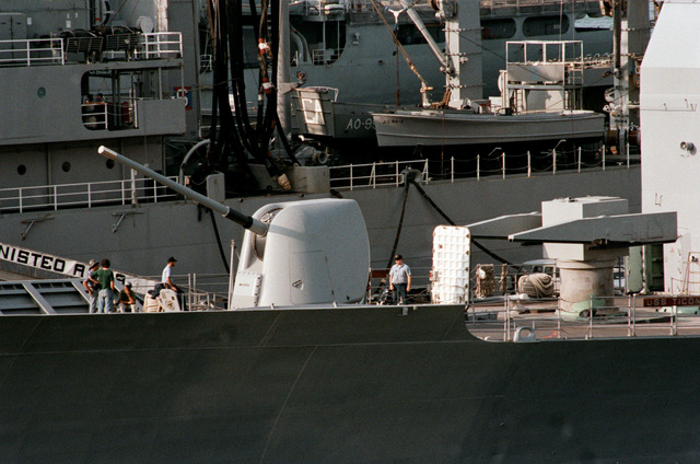 A port view of the fore deck aboard the Ticonderoga class Aegis guided missile cruiser USS TICONDEROGA (CG 47) moored at the naval station. Note the Mark 26 missile launcher, right