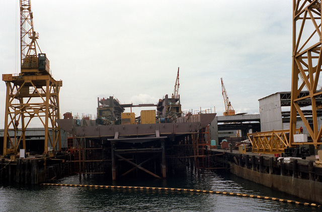 A stern view of the dock landing ship (LSD-42) under construction at the Lockheed Shipbuilding and Construction Company