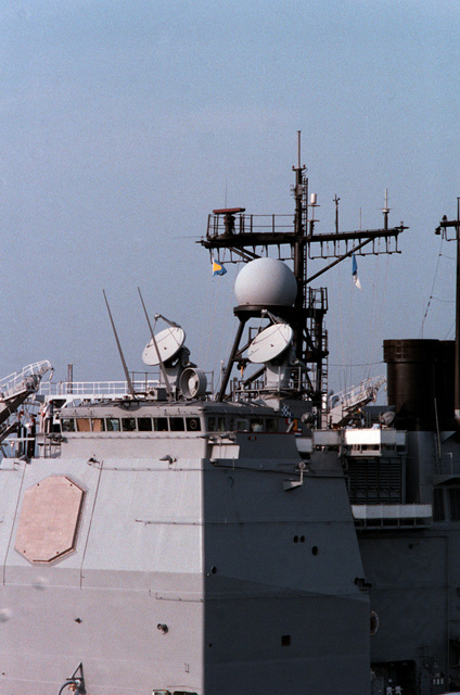 A view of the forward array of radar equipment aboard the Ticonderoga class Aegis guided missile cruiser USS TICONDEROGA (CG 47) moored at the naval station. Note the SPY-1A radar, bottom left, two Mark 99 missile directors and the SPQ-9A radar, directly above Mark 99 missile directors