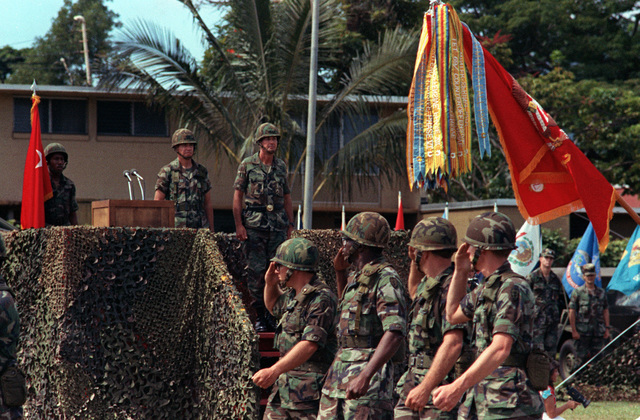 Artillerymen of the newly designated 8th Field Artillery Regiment pass in review during a ceremony in which the 3rd Battalion 13th Field Artillery, is being deactivated and redesignated as the 7th Battalion, 8th Field Artillery Regiment. Observing from the reviewing stand are Major General William H. Schneider and Colonel David J. Lynch