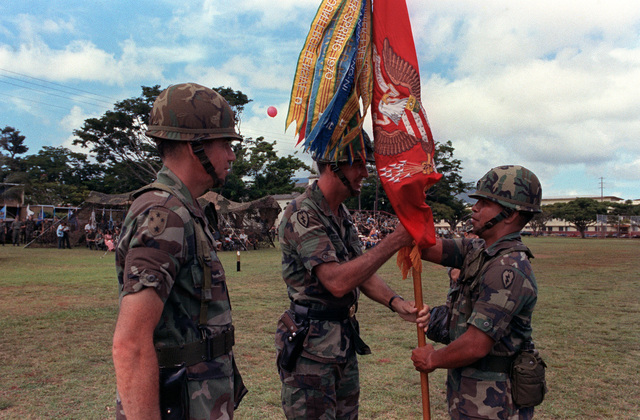 Lieutenant Colonel Edward T. Teixeria, receives the colors of the newly designated 7th Battalion, 8th Field Artillery Regiment from Major General William H. Schneider, commander of the 25th Infantry Division. The 3rd Battalion, 13th Field Artillery, is be