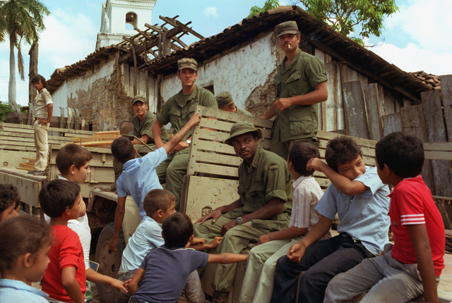 Members of the 360th Transportation Company talk with a group of Honduran children during the Ahuas Tara II (Big Pine) operation