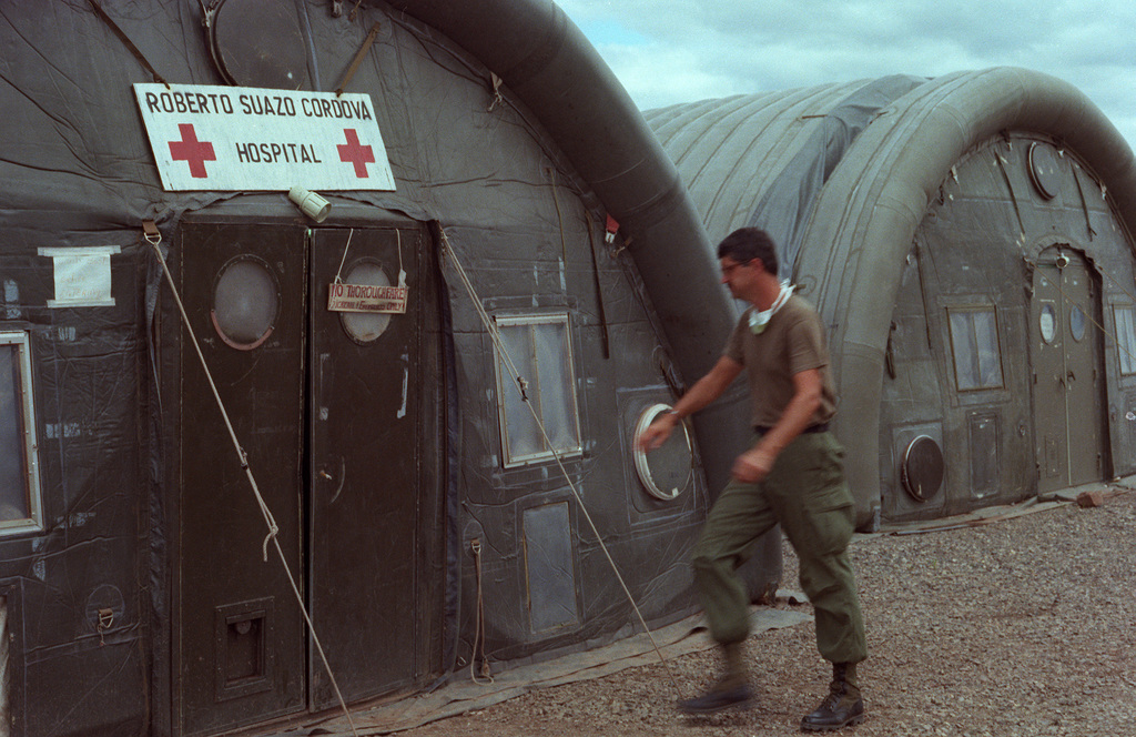 A soldier walks toward the main entrance of the 41st Combat Support Hospital during the Ahuas Tara II (Big Pine) operation. The hospital is named in honor of Honduran President Roberto Suazo Cardova