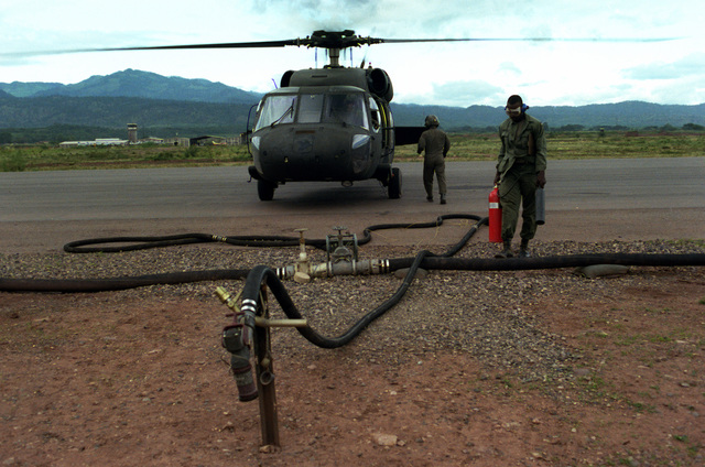 A UH-60 Blackhawk helicopter is refueled by Private First Class Darrell Wimbley, 102nd Quartermaster, Fort Campbell, Kentucky, during Operation Ahuas Tara II (Big Pine)