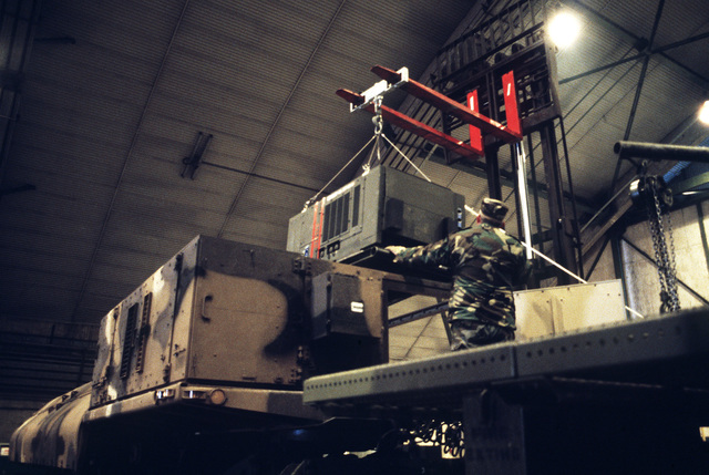 A forklift is used to lift the Ground Launch Cruise Missile equipment after its arrival inside the GLCM Alert Missile Maintenance Area