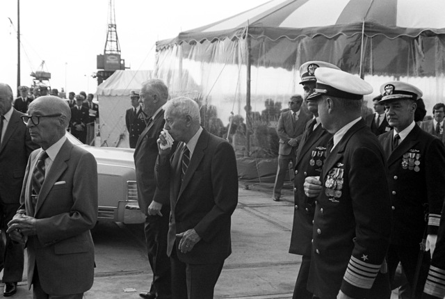 ADM Hyman G. Rickover (with handkerchief) and ADM Kinnaird R. McKee, Director of the Naval Nuclear Propulsion Program, arrives for the launching ceremony for the nuclear-powered strategic missile submarine HENRY M. JACKSON (SSBN-730)