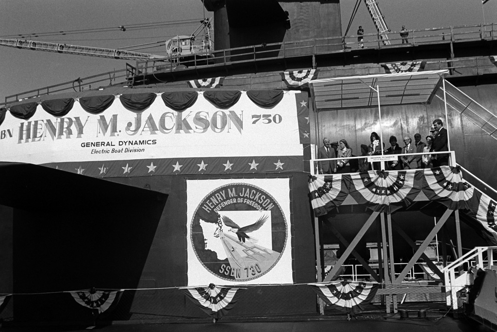 Anna Marie Jackson, daughter of the late Sen. Henry M. Jackson, D-Washington, and sponsor of nuclear-powered strategic missile submarine HENRY M. JACKSON (SSBN-730), prepares to christen the ship with a bottle of champagne during the launching ceremony