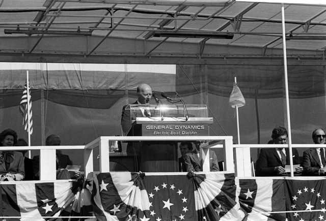 Fritz G. Tovar, General Manager of the Electric Boat Division of General Dynamics Corp., addresses guests and spectators attending the launching ceremony for the nuclear-powered strategic missile submarine HENRY M. JACKSON (SSBN-730)