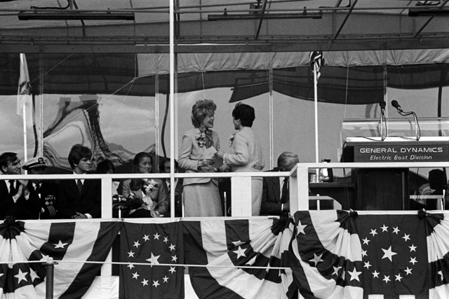 Joan Clark, wife of National Security Advisor William P. Clark, presents a letter from President Reagan to Helen Jackson widow of the late Sen. Henry M. Jackson, D-Washington. The presentation is taking place during the launching ceremony for the nuclear-powered strategic missile submarine HENRY M. JACKSON (SSBN-730)