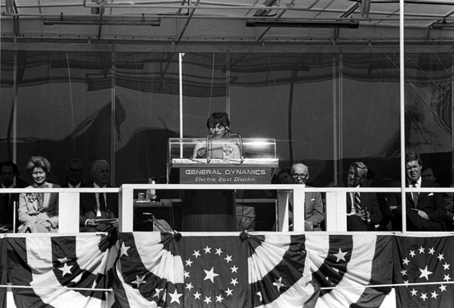 Joan Clark, wife of National Security Advisor William P. Clark, reads a letter from President Reagan to the family of the late Sen. Henry M. Jackson, D-Washington. She is participating in the launching ceremony for the nuclear-powered strategic missile submarine HENRY M. JACKSON (SSBN-730)