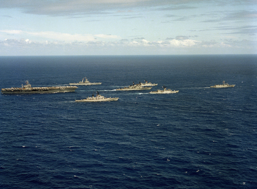 A starboard beam view of the nuclear-powered aircraft carrier USS CARL VINSON (CVN 70) underway near Hawaii with its battle group. Left to right: USS TEXAS (CGN 39), USS WORDEN (CG 18), USS HEWITT (DD 966), USS BARBEY (FF 1088), USS COOK (FF 1083), and USS SIDES (FFG 14) to be commissioned on April 14, 1985