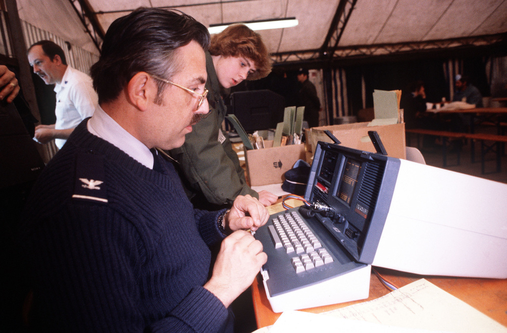 Colonel (Dr.) Doug Legowik uses a computer to help identify Marine casualties arriving from Beirut, Lebanon. The casualties are the result of a terrorist bomb attack at the Marine barracks and headquarters building