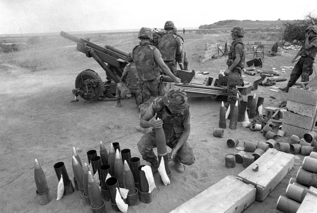 82nd Airborne Division artillerymen prepare to fire an M102 105 mm howitzer while providing artillery support for the multiservice, multinational Operation URGENT FURY