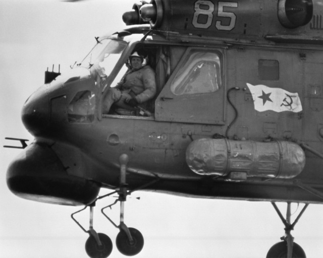 A close-up in the left side view of Ka-25 Hormone helicopter in flight as its pilot conducts anti-submarine warfare operations