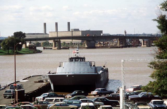 A port bow view of the surface effect ship 200 (SES-200) moored at the Navy Yard. Naval Sea Systems Command procured a 110-foot commercial SES and increased its length-to-beam ratio by installing a 50-foot hull extension amidships. This was necessary to validate high length-to-beam research